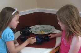Katie and her friend Caroline having a Tea Party.